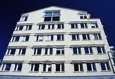 New Aparment against blue sky. New low rise apartments, with blue sky and white paint work stock photography