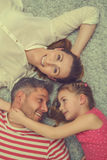 New apartement family. Family lying on the woolen floor Stock Photo