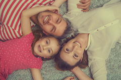 New apartement family. Family lying on the woolen floor Royalty Free Stock Image