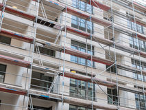 New Apartment Building Covered with Scaffolding Stock Photo
