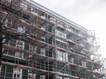 New Apartment Building Covered with Scaffolding Royalty Free Stock Images