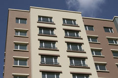 New apartment building under clear blue sky. New modern apartment building under clear blue sky Royalty Free Stock Photography