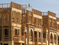 New apartment building under construction on sunny day on blue sky background stock photo