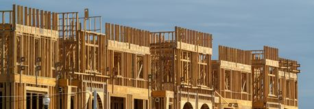 New apartment building under construction on sunny day on blue sky background stock image