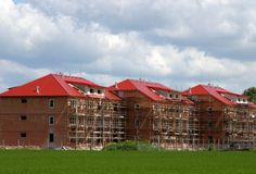New apartment buildings. A view across an open, grassy area to new apartment buildings under construction Royalty Free Stock Photography