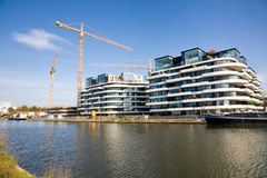 New apartment buildings, Hasselt, Belgium. Hasselt, Belgium - 2015, October 26 : Construction site of new flats on the quayside of the harbour of Hasselt on the royalty free stock photo