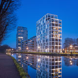 New apartment buildings reflected in canal at twilight, Turnhout, Belgium. Stock Photography