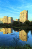 New apartment buildings on the river bank. Balashikha, Russia. New residential district on the bank of the river Pekhorka in the last rays of the sun Stock Images