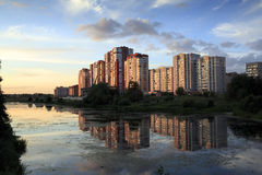 New apartment buildings  on the river bank at sunset. Balashikha, Russia. Stock Image