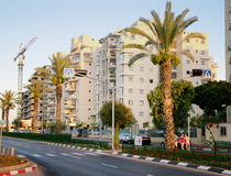 Apartment buildings at sunny early evening. Rishon Le Zion, Israel - August 6, 2013: New apartment buildings at sunny early evening in Golda Meir Street in Stock Photos
