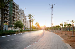 New apartment buildings at sunset. Rishon Le Zion, Israel - August 6, 2013: New apartment buildings at sunset in Golda Meir Street in Rishon Le Zion, Israel Royalty Free Stock Images