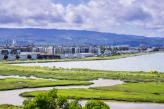 New apartment buildings under construction on the shoreline of San Francisco bay. As seen from Bedwell Bayfront Park, Menlo Park, Silicon Valley, California Royalty Free Stock Photos
