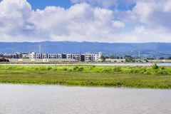 New apartment buildings under construction on the shoreline of San Francisco bay. As seen from Bedwell Bayfront Park, Menlo Park, Silicon Valley, California Stock Photography