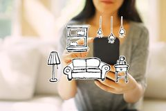 New apartment dream with woman using a smartphone. New apartment dream with woman using her smartphone in a living room royalty free stock image