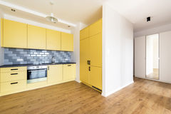 New apartment, empty room with domestic kitchen Royalty Free Stock Images