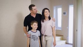 New apartment and happy young family. Proud family standing in their new home stock footage