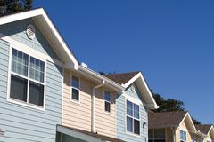 New Apartments. New modern rental apartments with horizontal siding against a blue sky background Stock Images