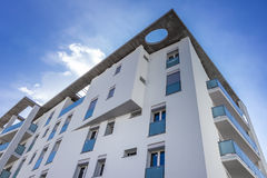 New apartments. White living house with apartments with sky background royalty free stock image