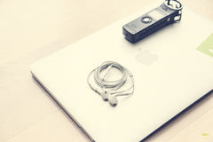 New Apple Earbuds on Macbook Air Royalty Free Stock Photo