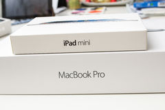 New Apple iPad Mini box above the new Apple MacBook Pr Royalty Free Stock Photos