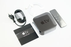 New Apple TV unboxing Stock Photography