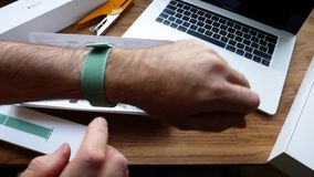 New Apple Watch 42mm marine green sport loop. Paris, France - Apr 24, 2018: New Apple Watch Series 3 smartwatch change strap to the new 42mm Marine Green Sport stock video footage