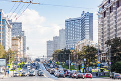 New Arbat Street. MOSCOW - SEPTEMBER 15, 2015: Heavy traffic on New Arbat Street. The modern six-lane avenue was constructed between 1962 and 1968 Stock Images