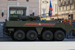 A new armored personnel carrier Russian army. A armored personnel carrier Russian army moving on the road royalty free stock images