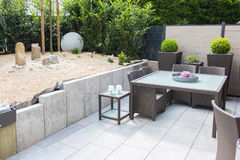 Free New Arranged Stone Garden With Terrace And Table And Chairs Stock Images - 73336404