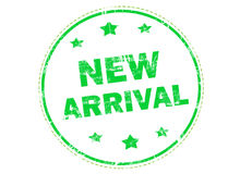 New arrival grunge rubber stamp. New arrival on green  grunge rubber stamp Stock Photo