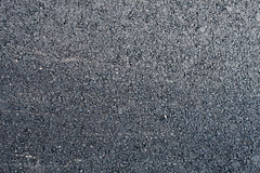 New asphalt road background. Top close-up horizontal view of new asphalt road Royalty Free Stock Images