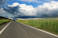 New asphalt road on european countryside Royalty Free Stock Photos
