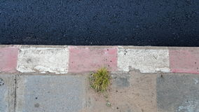 New asphalt road and old dirty footpath Stock Photos