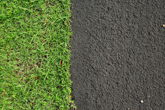 New asphalt road surface and green grass. Background Stock Image
