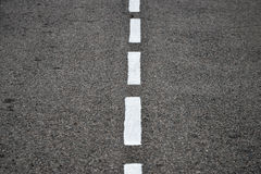 New asphalt texture with white dashed line Royalty Free Stock Image