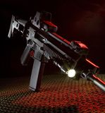 New assault rifle. Assault rifle that is on netting with red back lighting stock image