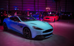 New Aston Martin Vanquish. Showcase of the new 2013 Aston Martin Vanquish along with a selection of luxury and exotic jets and automobiles at the festivals of Royalty Free Stock Photo