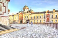 Abkhazia. New Athos Simon the Zealot Monastery. NEW ATHOS, ABKHAZIA - April 26.2015: Complex of buildings of the ancient Christian monastery on Mount Athos Royalty Free Stock Photo