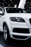 New Audi Q7, SUV quattro. Beautiful and brandnew Audi Q7  quattro, SUV, image shows a part of the modern frontlights, white colored car Royalty Free Stock Photography