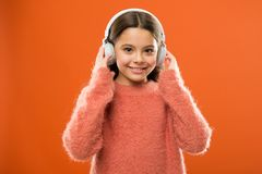 A new audio technology is coming. Little girl wearing wireless stereo headphones. Modern technology. Technology and. Music. Stereo sound technology stock images