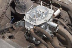 New automobile carburetor. Motor car compartment and a new carburetor Stock Photos