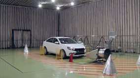 New automobile is standing in acoustic anechoic chamber for testing during noise measurement. In automobile factory stock video