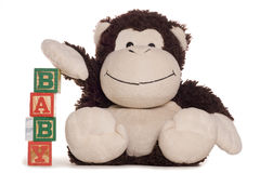 New baby alphabet blocks with soft toy Stock Photos