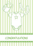 New baby arrival card. With clothes, vector illustration Stock Photo