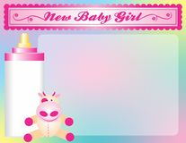 New Baby girl arrival announcement. Background with cow toy and baby bottle Royalty Free Stock Images