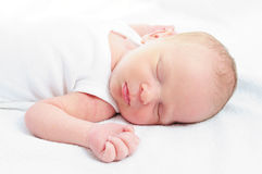 New baby sleeping on blanket. Happy baby boy girl sleeping dream Royalty Free Stock Images