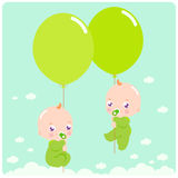 Baby twins with balloons Stock Photo