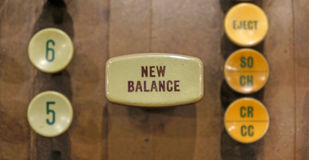 New Balance button on old automated banking machine. Stock Photo