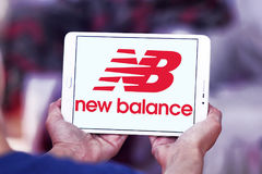 New balance logo. Logo of sporting fashion company, new balance on samsung tablet in hands Royalty Free Stock Photo