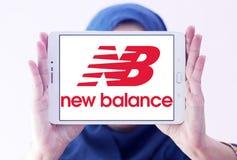New balance logo. Logo of sporting fashion company, new balance on samsung tablet holded by arab muslim woman Royalty Free Stock Image